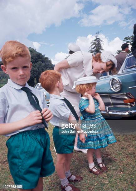 Scene at an all-white wedding in the Subukia Valley, part of the White Highlands of Kenya, featuring three red-haired children, the boys wearing...