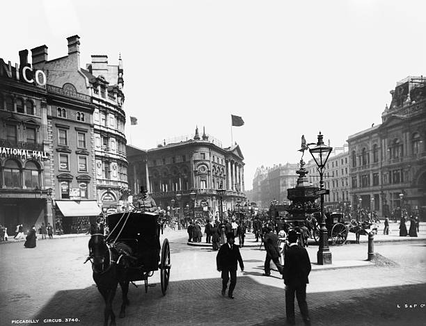 A scene at Piccadilly Circus in London, with a horsedrawn...
