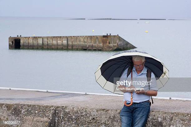 August 05:Scene at the harbour in Arromanches . At the back remains of the artificial harbour, constructed for the landing of the allies on August...