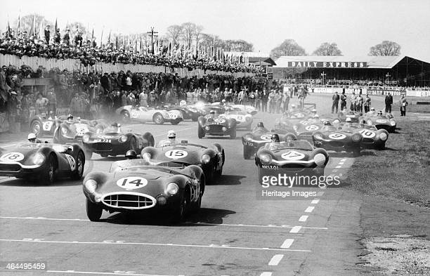 Scene at the start of a sports car race Silverstone Northamptonshire An Aston Martin leads the field as the cars are spread across the whole width of...