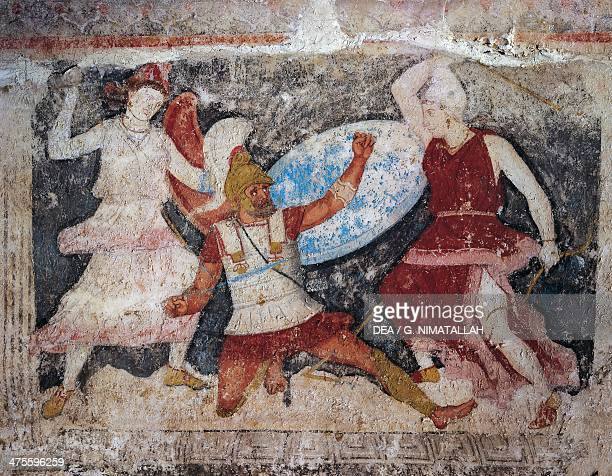 Scene depicting a Battle between soldiers and Amazons short side of the sarcophagus of the Amazons painted calcareous alabaster from Tarquinia Lazio...