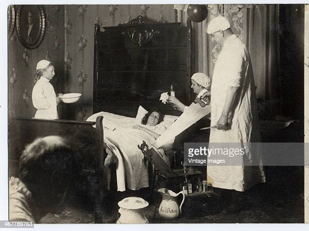 A scene depicting a surgeon preparing to remove a patient's limb circa 1890