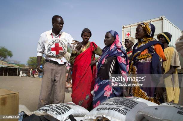 A scene during an International Committee of the Red Cross distribution of seeds agricultural tools and food staples to households in villages around...