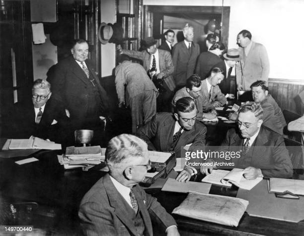 A scene during the crossexamination of ace government witness Aaron Sapiro at the Immigration Office on Angel Island during Harry Bridges'...