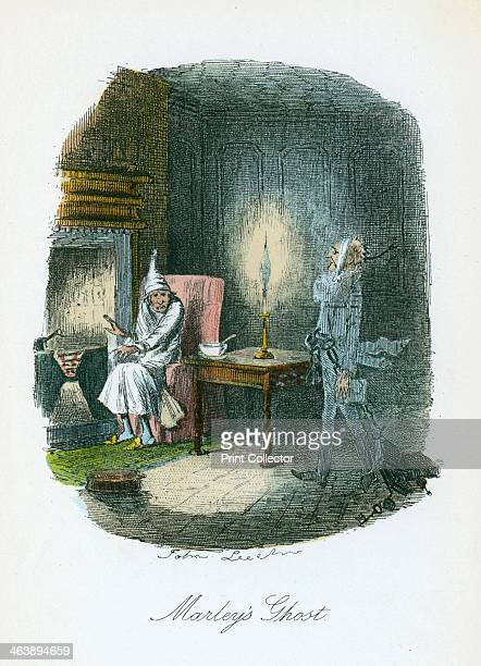 Scene from A Christmas Carol by Charles Dickens, 1843. The irascible, curmudgeonly Ebenezer Scrooge, sitting alone on Christmas Eve, is visited by...