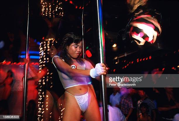Scene from a GoGo bar in the redlight district of Patpong Bar girls dance on stage for customers Most of these women are sexworkers