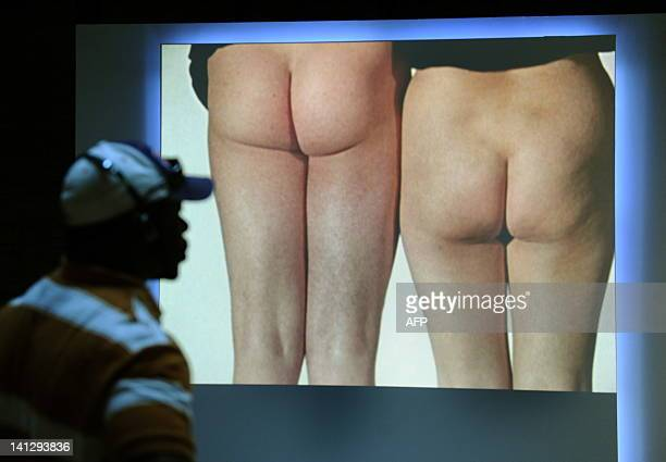 A scene from a short film known as 'Bottoms by Yoko Ono and John Lennon' shown Lennon and Ono two of of 365 volunteers' buttocks on display in a new...