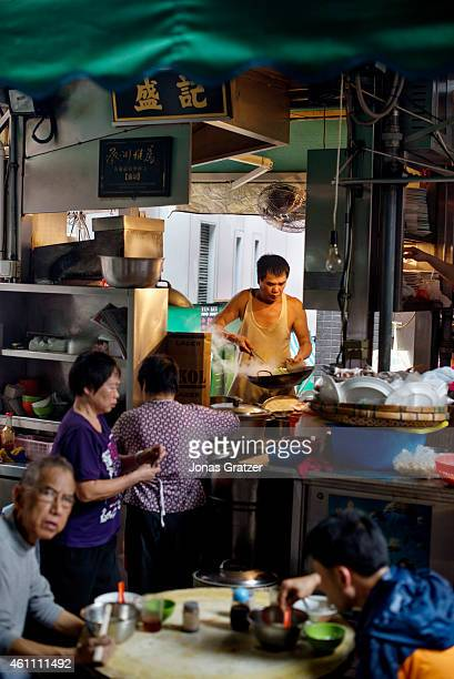 A scene from a streetfood district in an alleyway of Hong Kong city