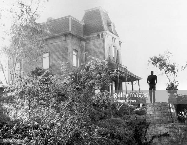 """Scene from Alfred Hitchcock's """"Psycho,"""" based on the novel by Robert Bloch, shows Norman Bates approaching the motel. Movie released in 1960."""