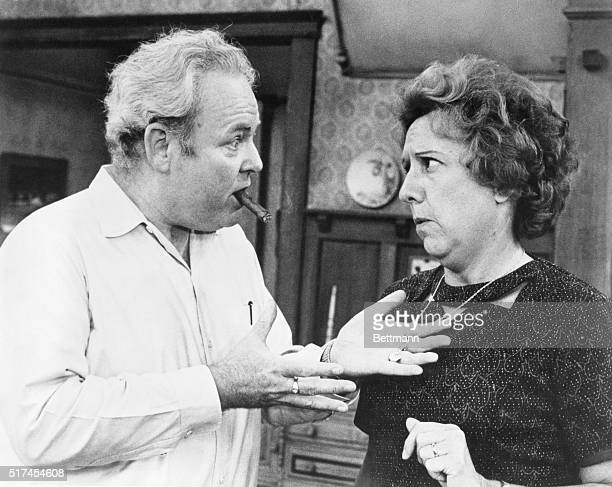 Scene from All in the Family where Archie Bunker is lecturing his wife, Edith Bunker about a piece of jewelry she's wearing.