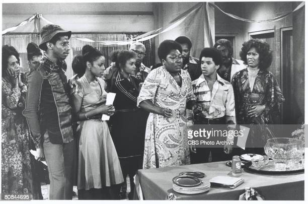 Scene from an episode of the television series 'Good Times' entitled 'The Big Move Part 2,' Los Angeles, California, 1976. Pictured from left, front...