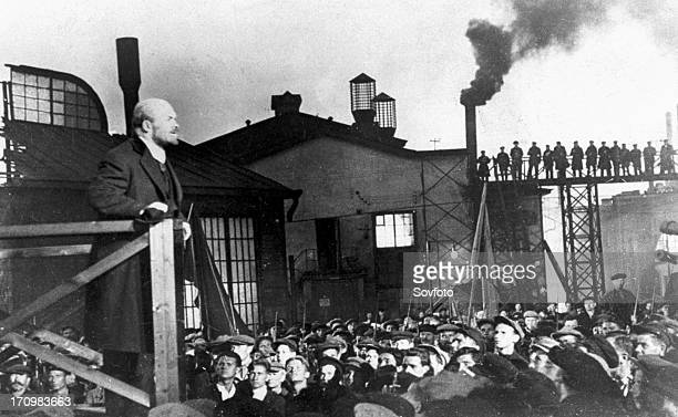 Bolshevik leader vladimir ilyich lenin addressing crowd of factory workers during october revolution