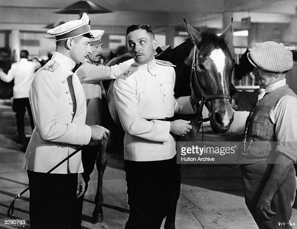 A scene from 'Anna Karenina' featuring Reginald Denny and Fredric March The film was directed by Clarence Brown for MGM