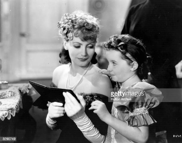 A scene from 'Anna Karenina' featuring Swedish actress Greta Garbo and child actress Cora Sue Collins as one of Dolly Oblonsky's children The film...