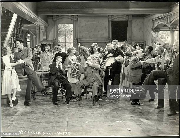 Scene from Columbia's Frank Capra productin of You Can't Take it With You the film version of Moss Hart's 1936 stagehit Front row lr Jean Arthur...