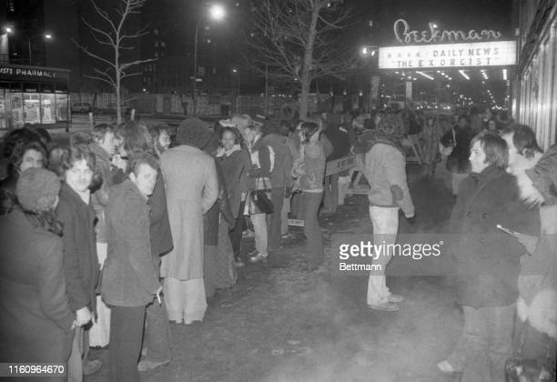 """Scene from Dante's """"Inferno?"""" It might be, with steam rising from a sidewalk grate, and a crowd lined up in 17-degree temperature waiting to see """"The..."""