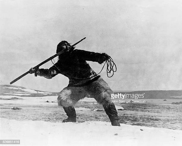 Scene from Flaherty's historic documentary Nanook of The North Nanook is about to hurl a spear Movie Still 1921