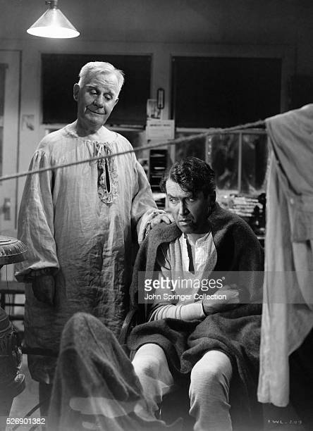 Scene from Frank Capra's 'It's a Wonderful Life' with Jimmy Stewart and 'Clarence' the Angel played by Henry Travers Movie still BPA2# 146