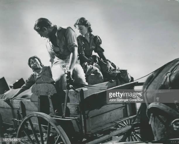 Scene from Gone with the Wind showing Rhett Butler Scarlett O'Hara Prissy fleeing Atlanta in wagon