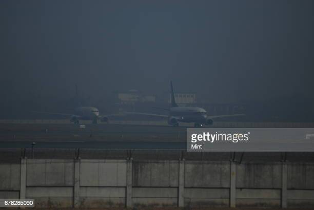 Scene from IGI airport Several international and domestic flights were delayed diverted and cancelled due to fog