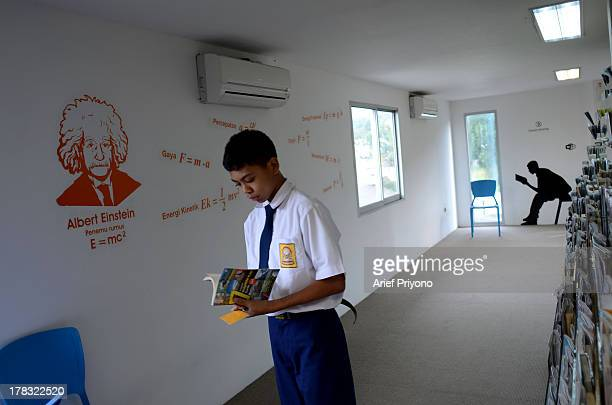 A scene from inside a unique library building 'AMIN' which is constructed out of seven cargo containers and is designed to be a comfortable space on...