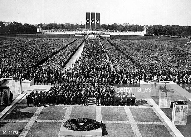 "Scene from Leni Riefenstahl's film ""Triumph of the Will"" : 100,000 members of the Nazi forces are inspected by Hitler during the Nazi congress of..."