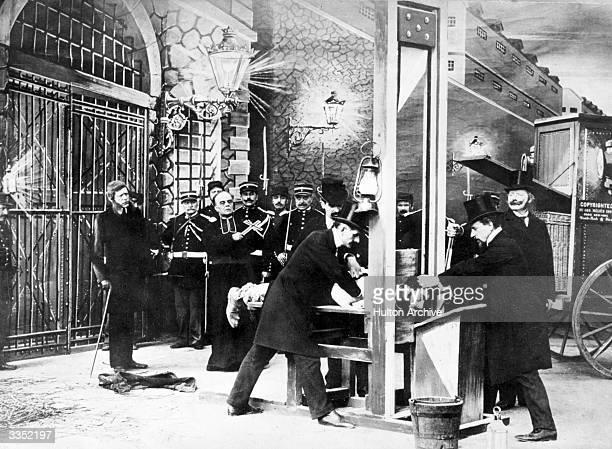 A scene from 'L'Histoire D'un Crime' a film by the French actor magician designer and theatre manager Georges Melies This execution scene with a man...