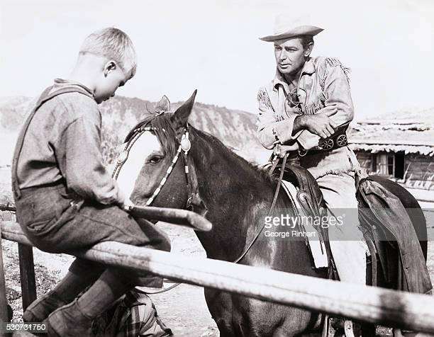 Scene from Paramount's Shane, starring Alan Ladd. Produced and directed by George Stevens. Brandon de Wilde played the young boy who is saddened by...