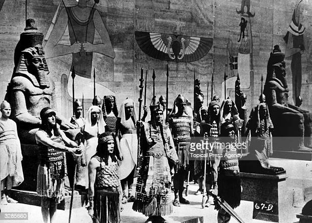 A scene from silent version of the epic film 'The Ten Commandments' also directed by Cecil B DeMille The Egyptian Pharaoh is surrounded by his guards...