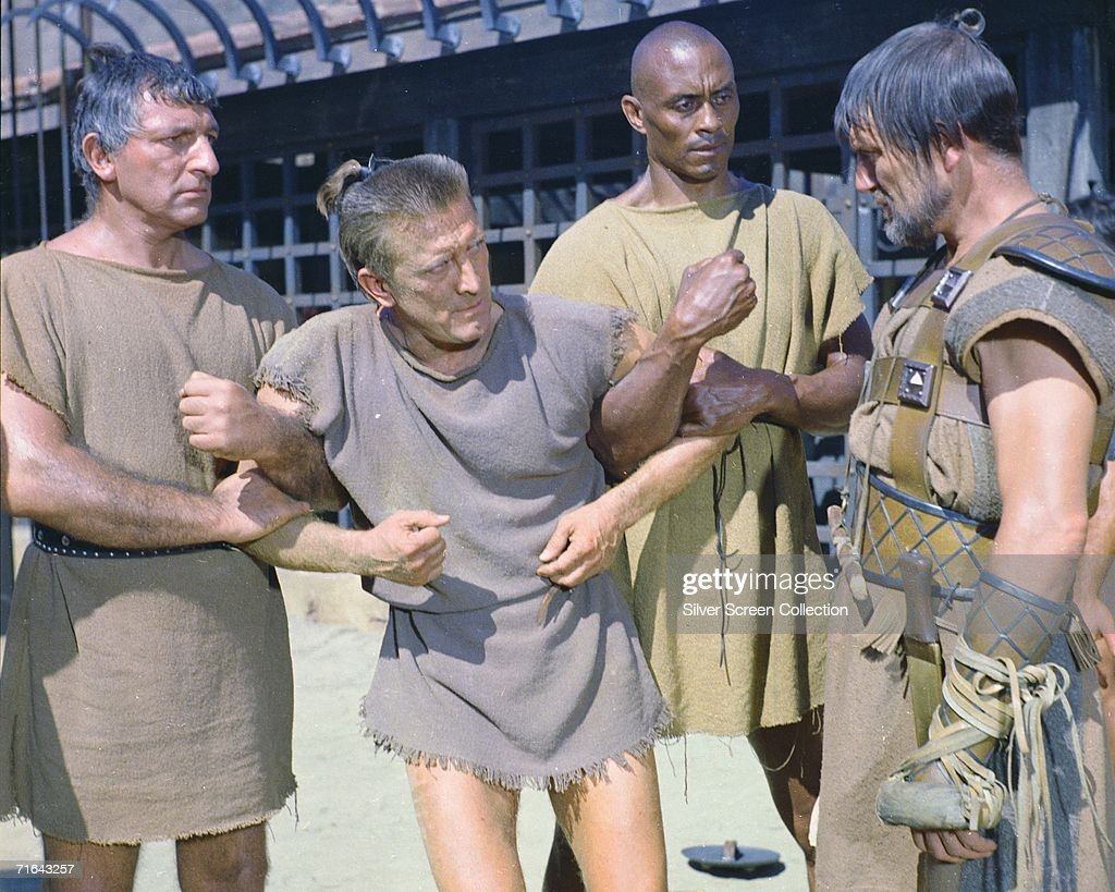 A scene from 'Spartacus', directed by Stanley Kubrick, with Kirk Douglas (centre, left) in the title role, Woody Strode (1914 -1994, centre, right) as Draba and Charles McGraw as Marcellus, 1960.