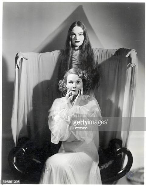 Scene from the 1943 Columbia pictures film The Return of the Vampire showing vampire Nina Foch standing behind a frightened victim