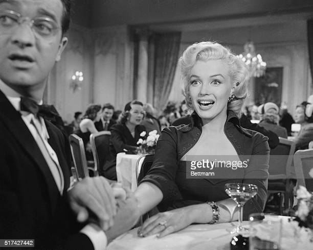 """Scene from the 1953 movie """"Gentlemen Prefer Blondes,"""" with Marilyn Monroe as Lorelei Lee. Marilyn shown here seated in a restaurant with a surprised..."""