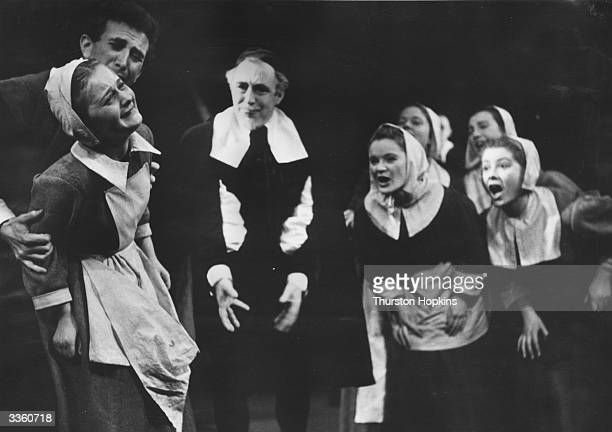 A scene from the Bristol Old Vic Company production of Arthur Miller's play 'The Crucible' in 1954 starring Abigail Williams John Hale and John...