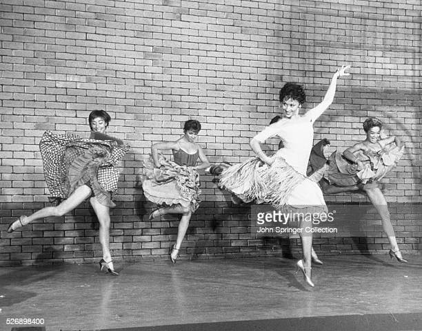 Scene from the Broadway musical West Side Story LR Lynn Ross unnamed actress Chita Rivera and Carmen Guitterez Undated photo