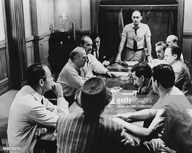 A scene from the film '12 Angry Men' 1957 Clockwise from left around the table actors Henry Fonda Ed Begley George Voskovec Robert Webber Martin...