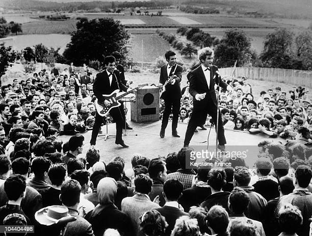 Scene from the film LA GUERRE DES KARTS with the rock group LES CHAUSSETTES NOIRES whose singer is Eddy MITCHELL. In this scene, the goup is...