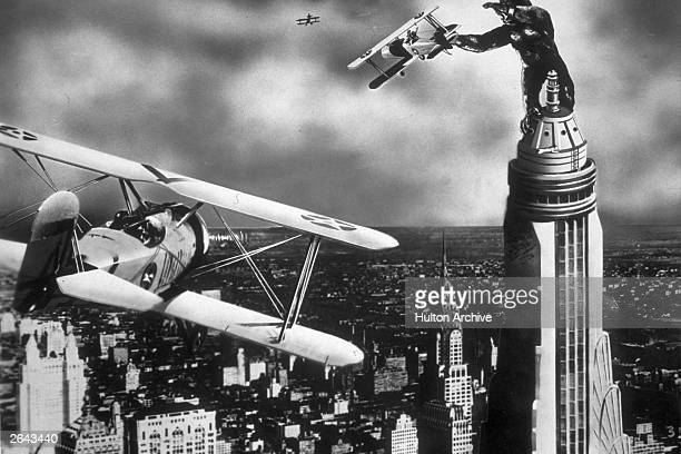 A scene from the film 'King Kong' with the giant gorilla astride a Manhattan skyscraper grabbing a passing aeroplane The film was directed by Merian...