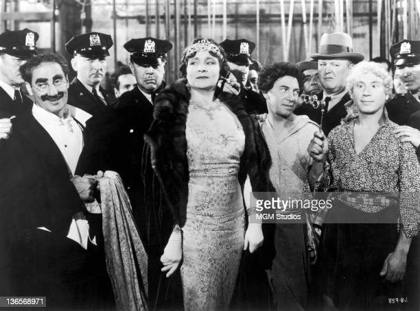 A scene from the Marx Brothers comedy 'A Night At The Opera' directed by Sam Wood 1935 Left to right Groucho Marx Margaret Dumont Chico Marx and...