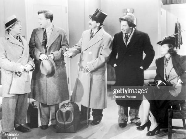 A scene from the Marx Brothers comedy 'Room Service' directed by William A Seiter 1938 Left to right Harpo Marx Frank Albertson Groucho Marx Chico...