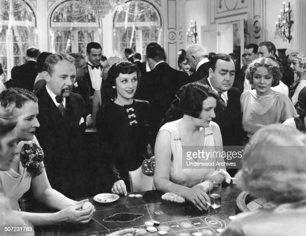 A scene from the movie 'Friends of Mr Sweeney' with Charles Ruggles Ann Dvorak Eugene Pallette and Rosalie Roy as they look over a gaming table in a...