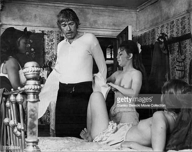 Scene from the movie 'Pat Garrett and Billy the Kid', featuring actor James Coburn in a brothel, 1973.