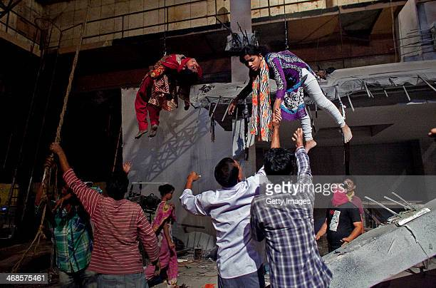 Scene from the movie titled 'Rana Plaza' is filmed February 7, 2014 in Dhaka, Bangladesh. The movie tells the love story of a male garment worker and...