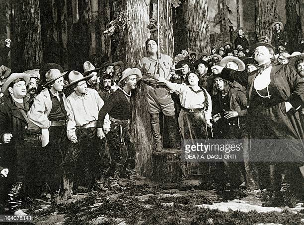 Scene from the premiere of La Fanciulla del West opera by Giacomo Puccini performed at New York in 1910 with Enrico Caruso as Johnson Milan Museo...