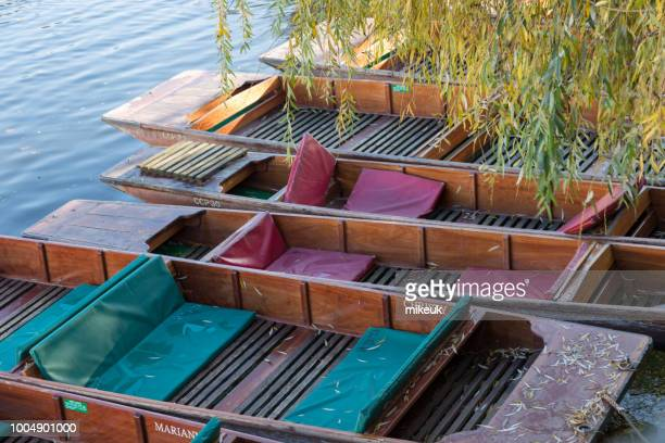 a scene from the river cam in the city centre of cambridge, england. it shows traditional tourist punt boats as well as the university and architecture of buildings of the town in summer. - as stock pictures, royalty-free photos & images