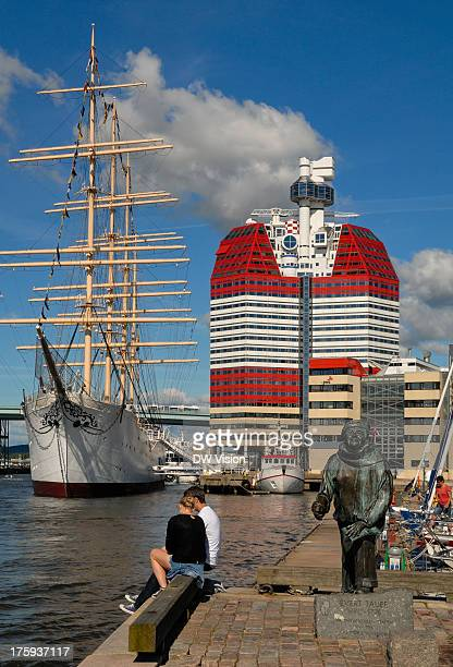 Scene from the riverfront in Göteborg with one of the landmarks called the lipstick in the background. The statue in the foreground is of Evert...