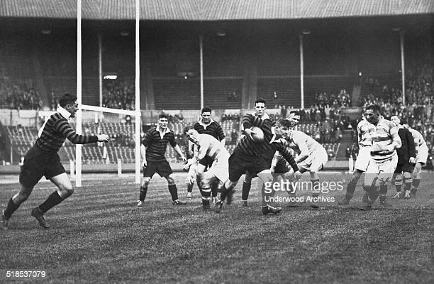 A scene from the Rugby League Challenge Cup Final held at Wembley Stadium between York and Halifax London England May 1931 Here a York player is...
