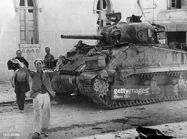Scene in a Messina street as a civilian welcomed the arrival of Allied forces in the the Sicilian city In background a US Army Sherman tank