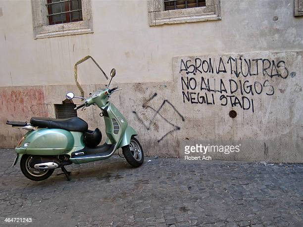 Scene in an alley in Rome, Italy. It took me awhile to figure out the graffiti. A.S. Roma is a football team. Ultras are radical hardcore fans. Digos...