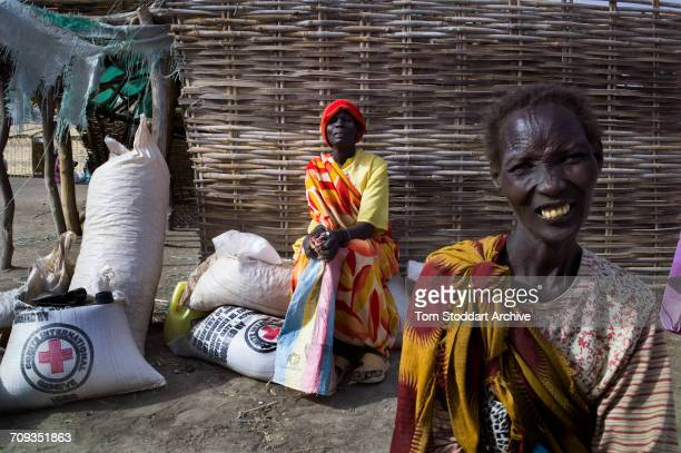 A scene in Nyintar village during an International Committee of the Red Cross distribution of seeds agricultural tools and food staples to households...