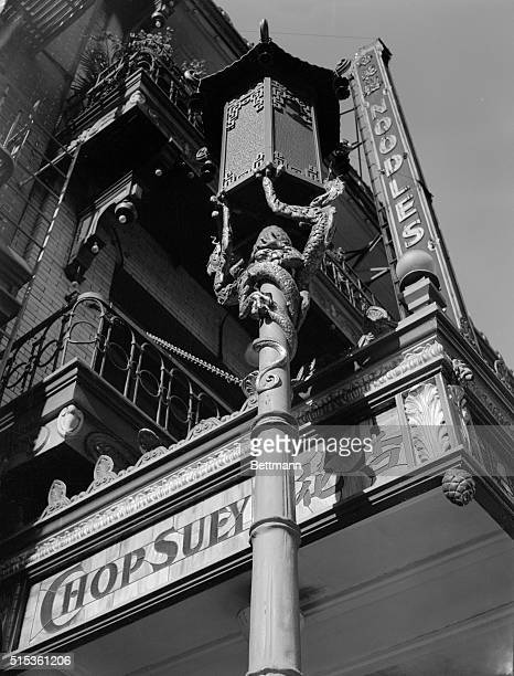 Scene in San Francisco's Chinatown street light fixture and chop suey joint